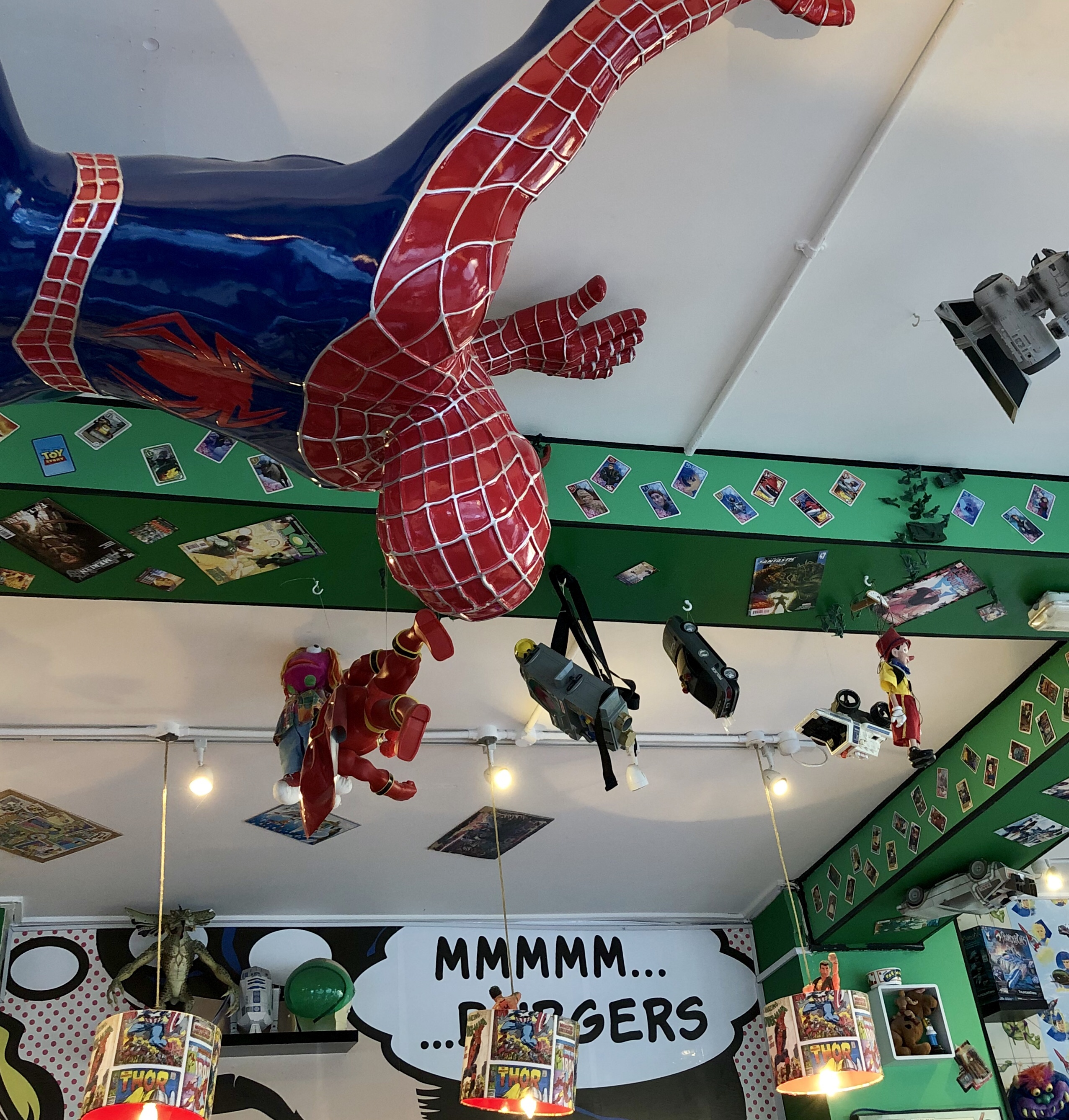 A picture of the inside of Atomic Burger, Oxford - including a giant spiderman on the ceiling!