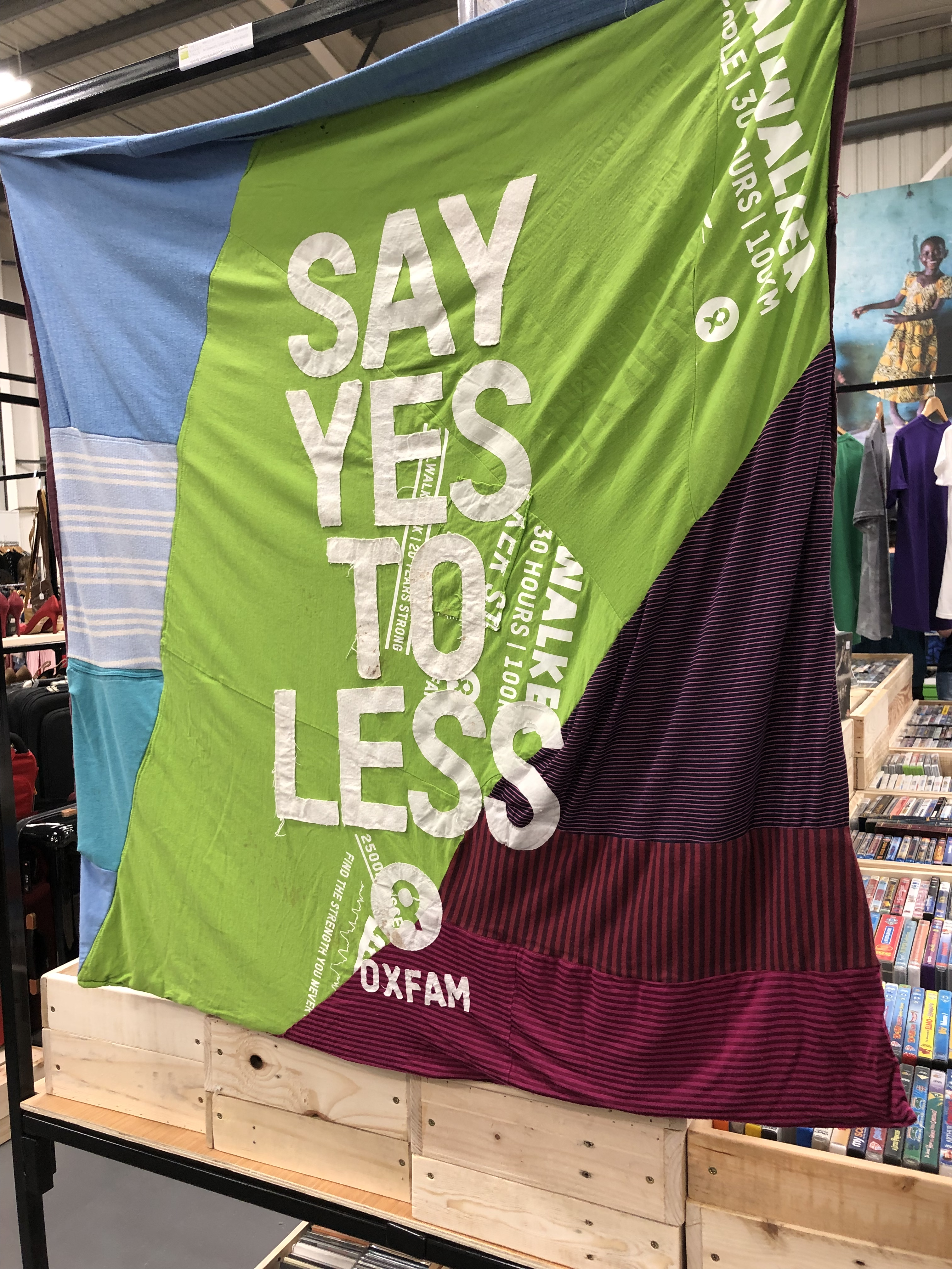 Sign reading say yes to less